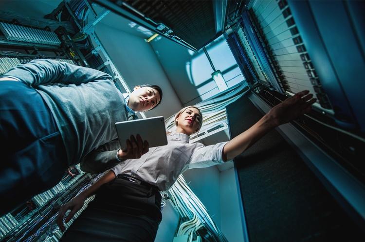 Engineers in a server room.jpg